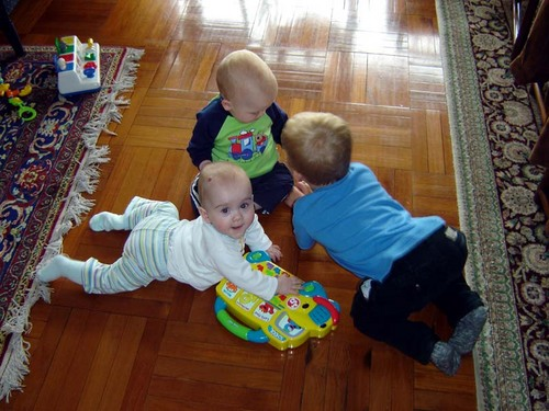 Sela, Jasper and Sebastian play on the floor.