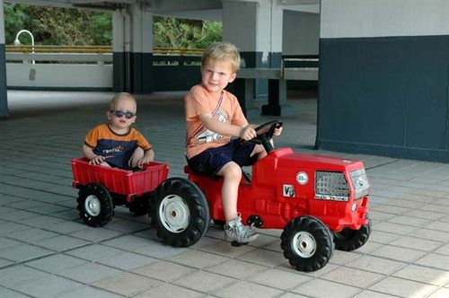 Sebastian & Jasper riding the tractor & trailer.